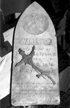 A headstone used as a satanic altar as seen in the Warren's Occult Museum.